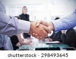 men shaking hands against
