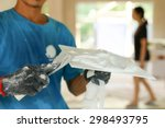 Small photo of Plasterer mixing a plaster on a tray for renovation decoration indoor