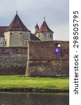 Small photo of FAGARAS, ROMANIA - MAY 6, 2015: The fortification walls and towers of the Fagaras fortress, built around 1310, one of the largest and best preserved feudal castles in Eastern Europe.