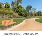 Wood Bench And Winding Park...