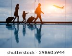 Silhouette of young family and...