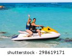 Man And Woman On A Jet Ski