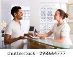 smiling guy in the waiting room ... | Shutterstock . vector #298664777
