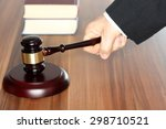 lawyer with hammer and books in ... | Shutterstock . vector #298710521
