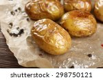 baked spicy potatoes on... | Shutterstock . vector #298750121