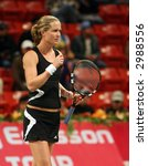 Small photo of Meghann Shaughnessy in action in the doubles vs Kirilenko/Hingis at Qatar Total Open, March 2, 2007.