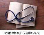 Stethoscope On Books On Wooden...