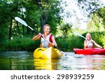 Woman Paddling With Canoe On...