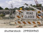 Small photo of WARRENVILLE, IL, USA - July 22, 2015: Road closure means detours for motorists and pedestrians during a civil engineering project to realign part of a river and replace an old bridge with a new one.
