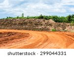 Red Road With Soil Wall And...