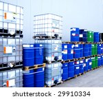 White Container And Blue Drums...