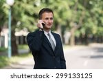 Young Businessman Talking On...