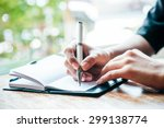close up of woman writing her...   Shutterstock . vector #299138774