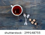Stock photo top view of cup of tea on vintage wooden background 299148755