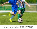 young boys playing football... | Shutterstock . vector #299157905