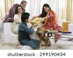 boy giving a gift to his sister ...   Shutterstock . vector #299190434