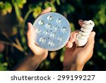 hands holding two energy saving ... | Shutterstock . vector #299199227
