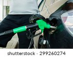 man fills up his car with a... | Shutterstock . vector #299260274