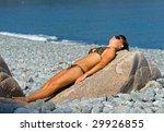 a girl sunburns on big stone on ...   Shutterstock . vector #29926855