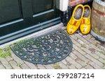 wooden shoes and doormat in... | Shutterstock . vector #299287214