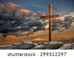 Wooden Cross On Rocky Hill At...