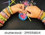 young girl weaves heart with... | Shutterstock . vector #299356814
