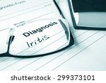 Small photo of Diagnosis list with Iritis and glasses.
