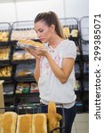 a woman smelling bread in the... | Shutterstock . vector #299385071