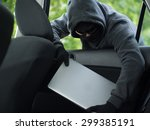 car theft   a laptop being... | Shutterstock . vector #299385191