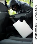 car theft   a laptop being... | Shutterstock . vector #299385371