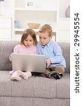 young children sitting on couch ... | Shutterstock . vector #29945554