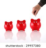 Hand putting coin into three hopeful piggy banks - stock photo