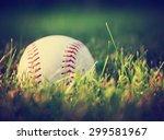 a baseball in a grass... | Shutterstock . vector #299581967
