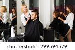 Small photo of Hairdresser makes the cut for man in the hairdressing salon