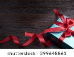 green gift box red bow on wood... | Shutterstock . vector #299648861