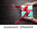 time gifts   gift box in hand... | Shutterstock . vector #299666249