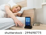 Young Woman Snoozing Alarm On...