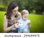 mother using wet wipes for her... | Shutterstock . vector #299699975