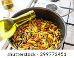 adding wine in colorful penne... | Shutterstock . vector #299773451