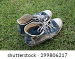 old   torn sneakers on green... | Shutterstock . vector #299806217
