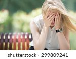 sad woman sitting on bench... | Shutterstock . vector #299809241