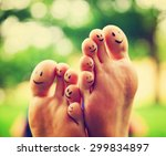 smiley faces on a pair of feet ... | Shutterstock . vector #299834897
