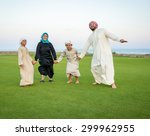 arabic family on green meadow... | Shutterstock . vector #299962955