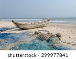 Small photo of ACCARA, GHANA - JANUARY 18, 2014: Fishing poor boat and nets on sea sand coast in rural fishing village. In 1957, Ghana became the first African nation to declare independence from colonization.