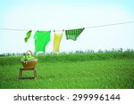 Stock photo laundry line with clothes in field 299996144