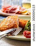 Small photo of Cutlet Cordon Bleu with salad on a plate