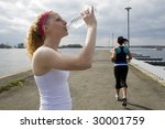 Two Women Jogging And Taking A...