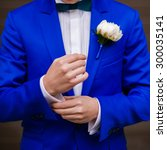 Groom In Blue Suit With Bouque...
