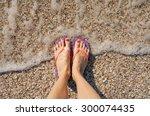 female legs wearing flip flops... | Shutterstock . vector #300074435