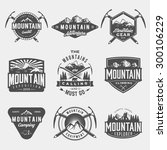 vector set of mountain exploration vintage logos, emblems, silhouettes and design elements. logotype templates and badges with mountains, forest, trees, tent, ice axe. outdoor activity symbols | Shutterstock vector #300106229
